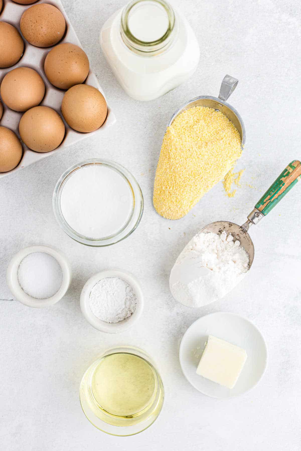Ingredients for cornbread muffins in dishes.