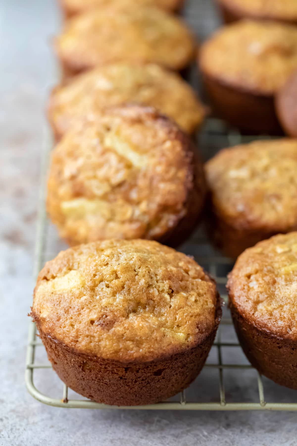 Apple cinnamon oatmeal muffins on a wire cooling rack.