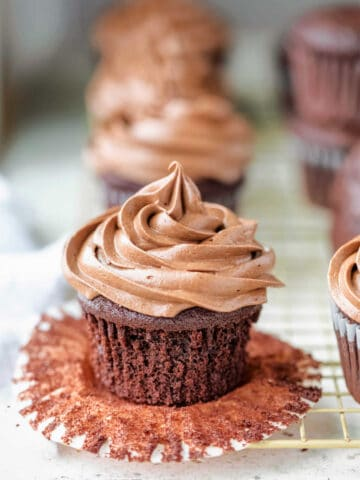 Swirl of chocolate cream cheese frosting on a chocolate cupcake.