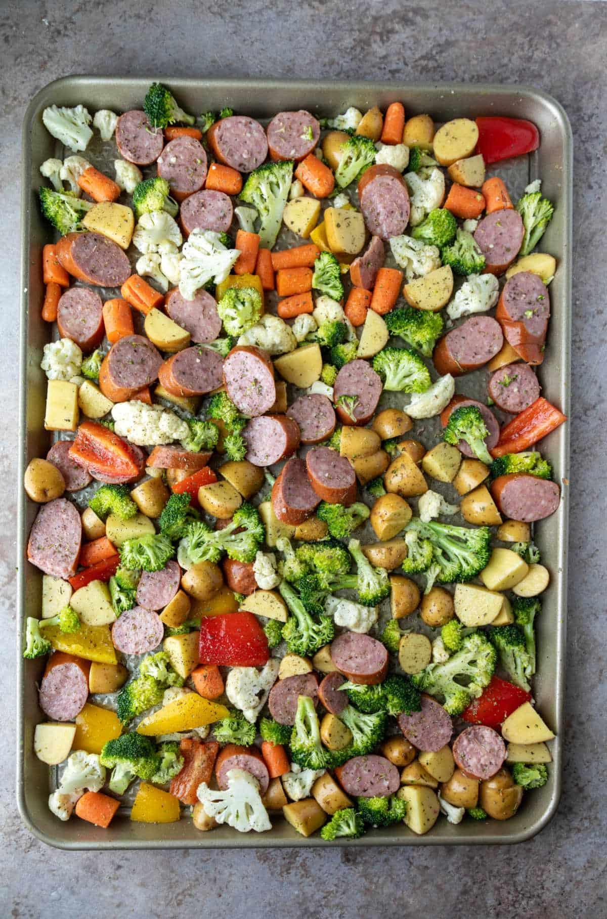 Sausage and veggies on a sheet pan.