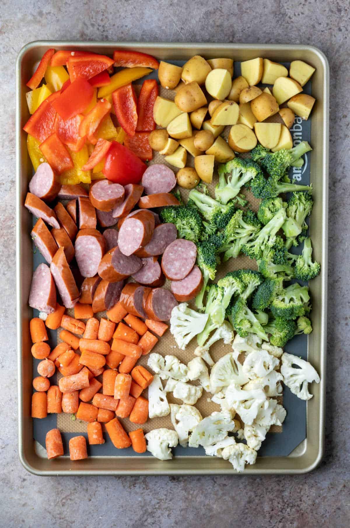Veggies and sausage on a sheet pan.