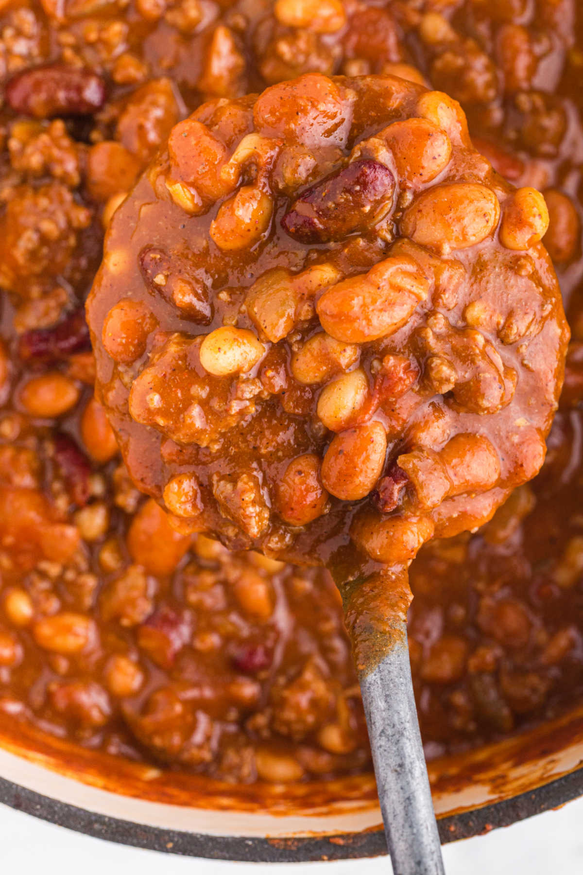 Close up photo of chili on a spoon.