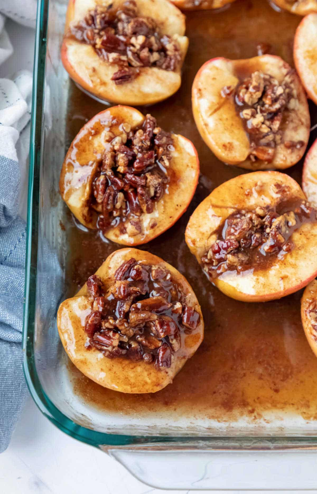 Baked apples in glass baking dish.