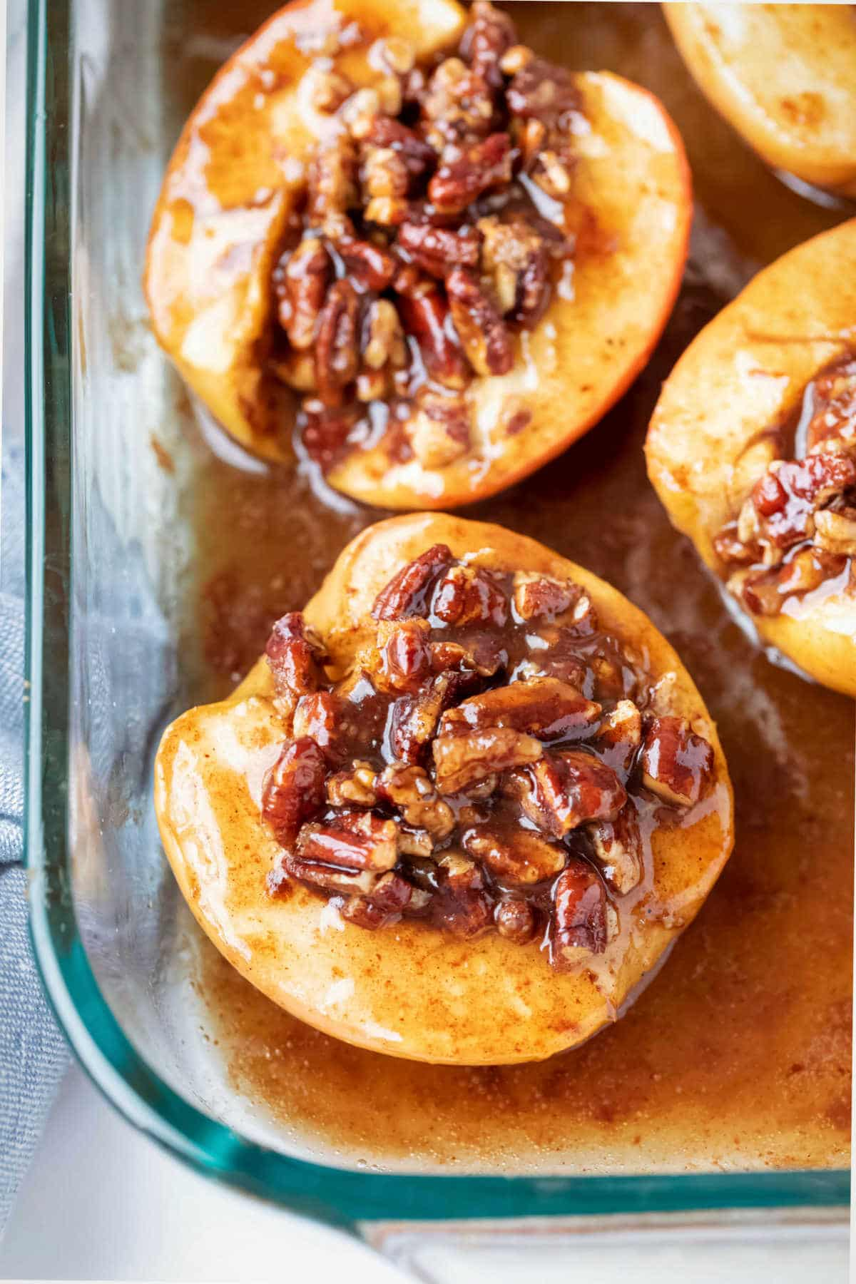 Baked apples in a glass baking dish.