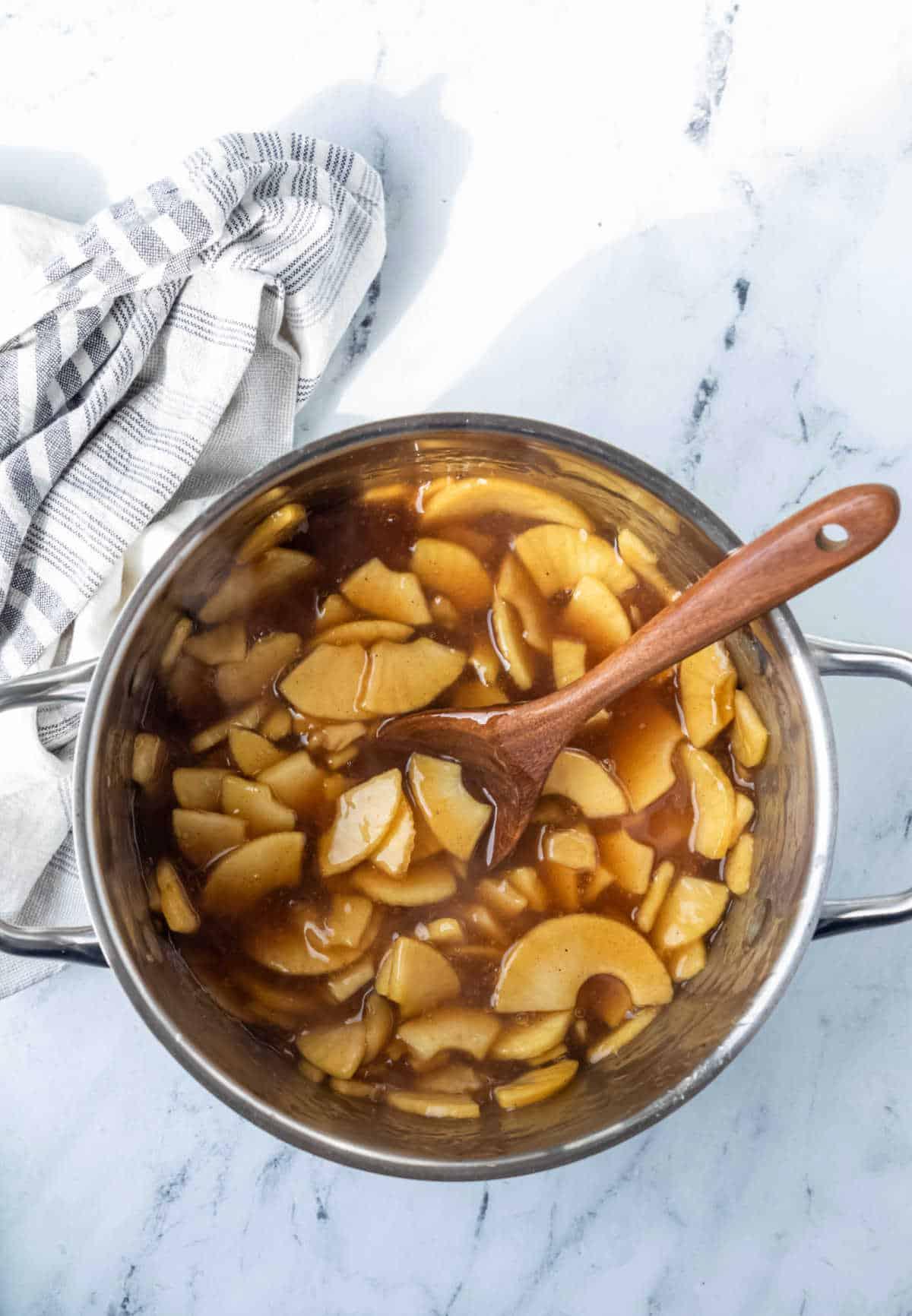 Apple pie filling in a saucepan.