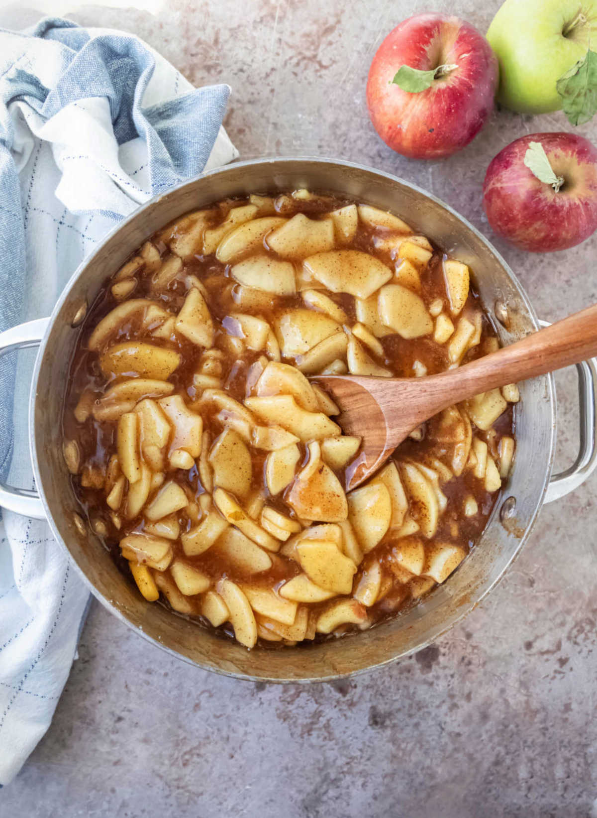 Cooked apple pie filling in a saucepot.